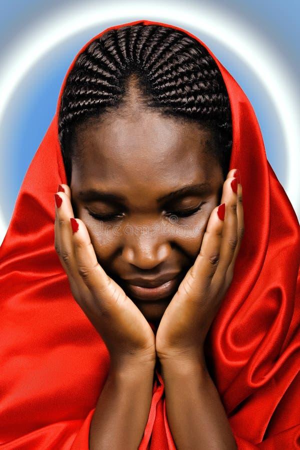 Femme chrétienne africaine photographie stock