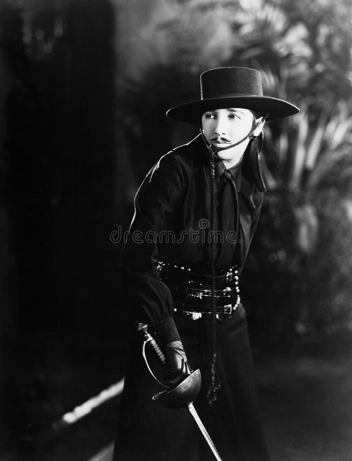 Femme comme Zorro (toutes les personnes représentées ne sont pas plus long vivantes et aucun domaine n'existe Garanties de fourni image libre de droits