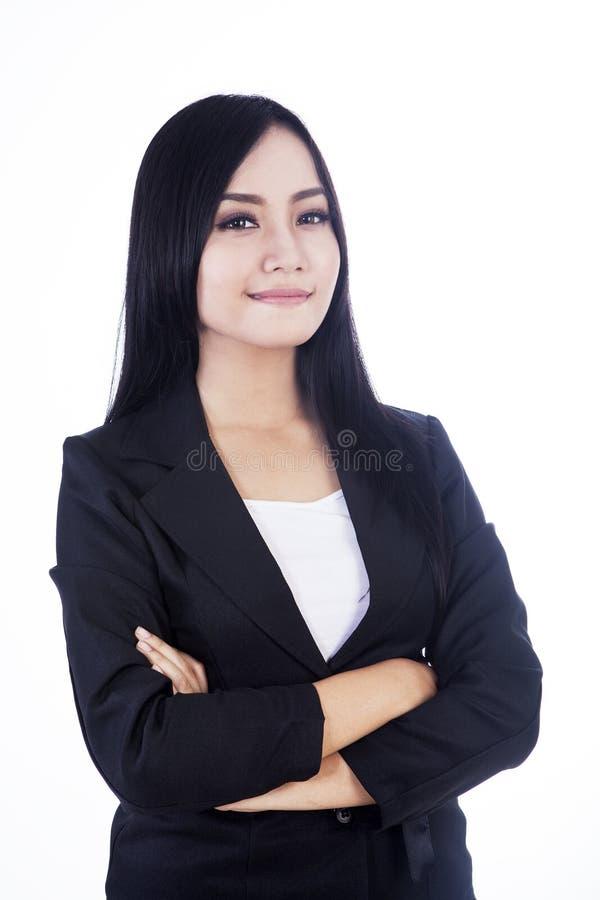 Femme confiante d'affaires d'isolement dans le blanc image stock