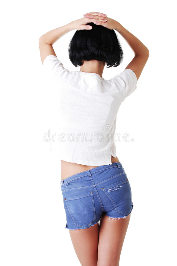 Femme convenable dans des shorts de jeans images stock