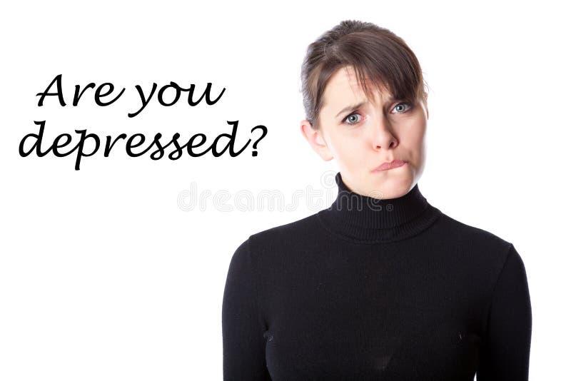 Femme déprimée dans un studio images stock