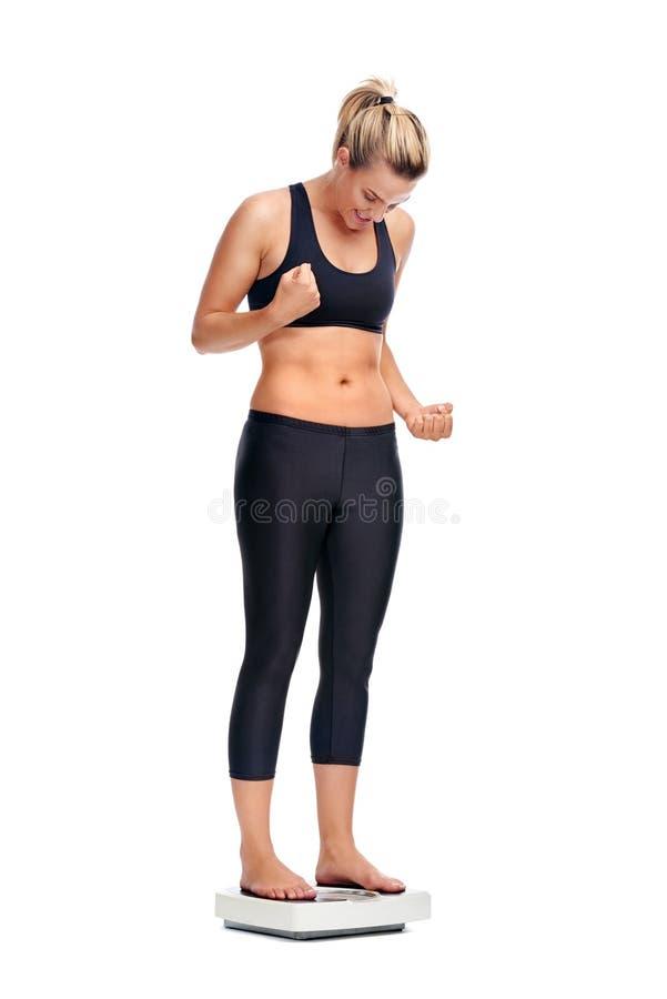 Femme d'échelle de Weightloss photographie stock
