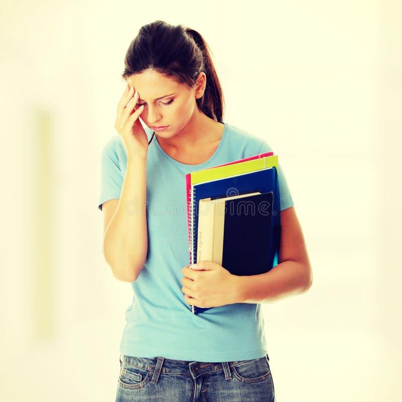 Femme d'étudiant avec la dépression image libre de droits