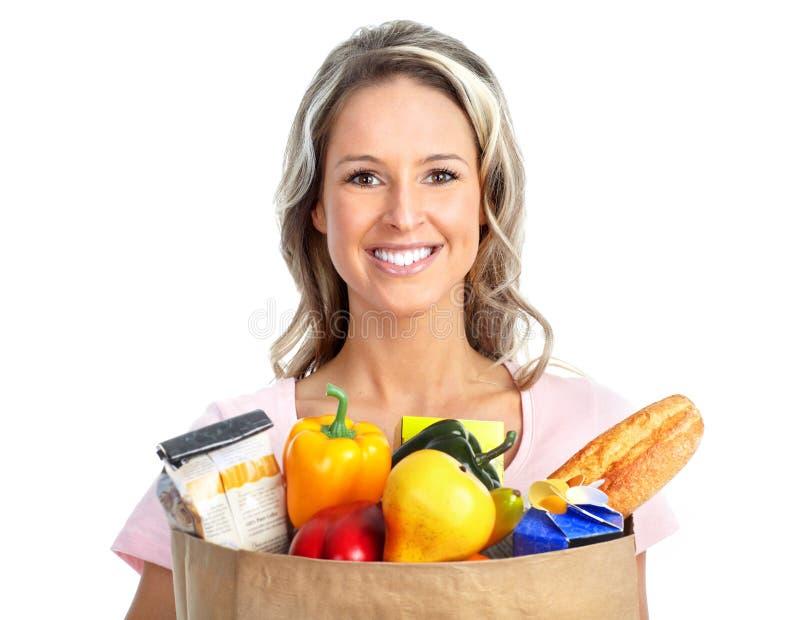 Femme d'achats avec un sac de nourriture photos stock