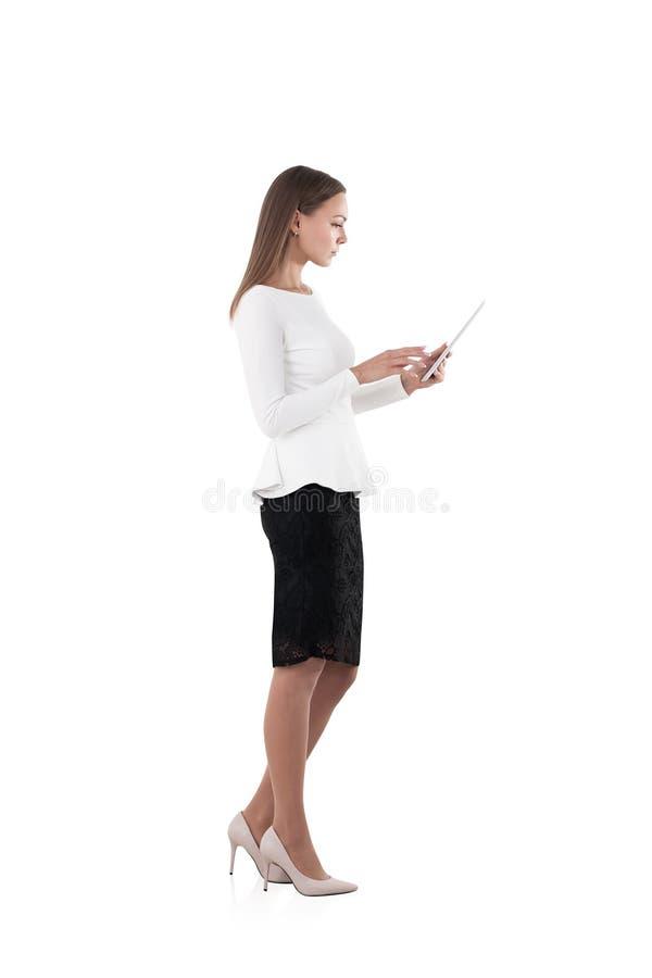 Femme d'affaires à l'aide de la tablette photo libre de droits