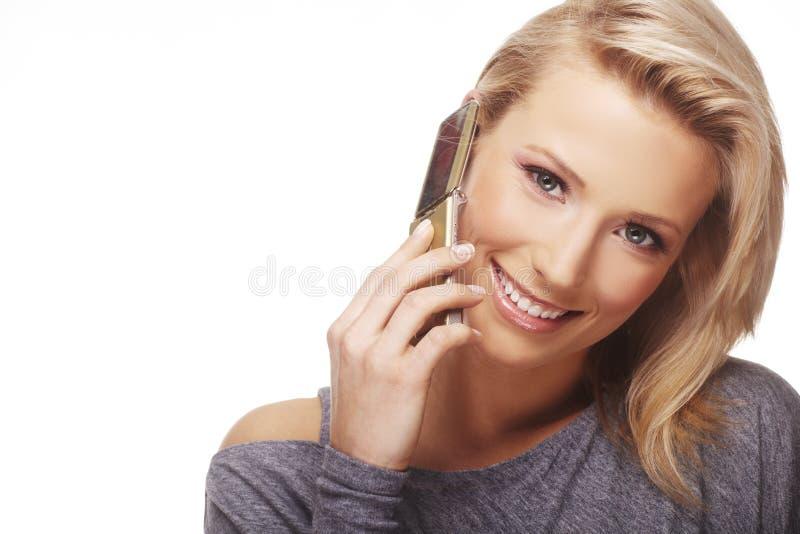 Femme d'affaires à l'aide du téléphone portable image libre de droits