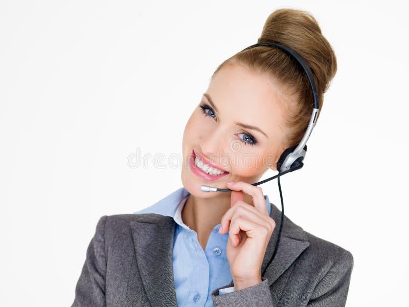 Femme d'affaires élégante de sourire dans un casque images libres de droits