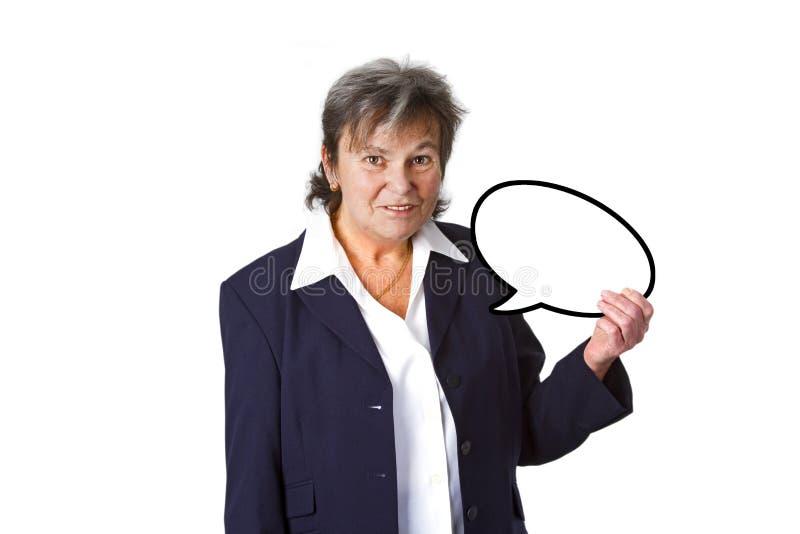 Femme d'affaires aînée avec la bulle de pensée photos stock