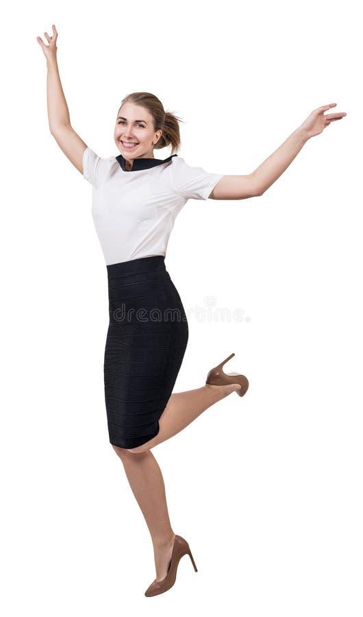 Femme d'affaires adulte gaie dans sauter de jupe photo stock