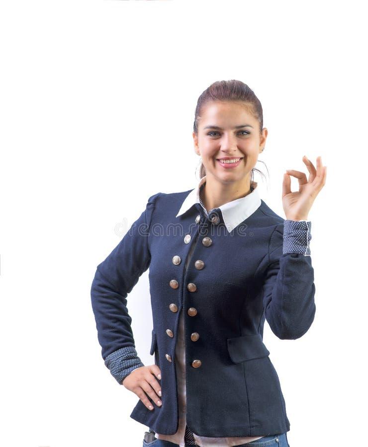 Femme d'affaires affichant le sourire EN BON ÉTAT de signe de main heureux image stock