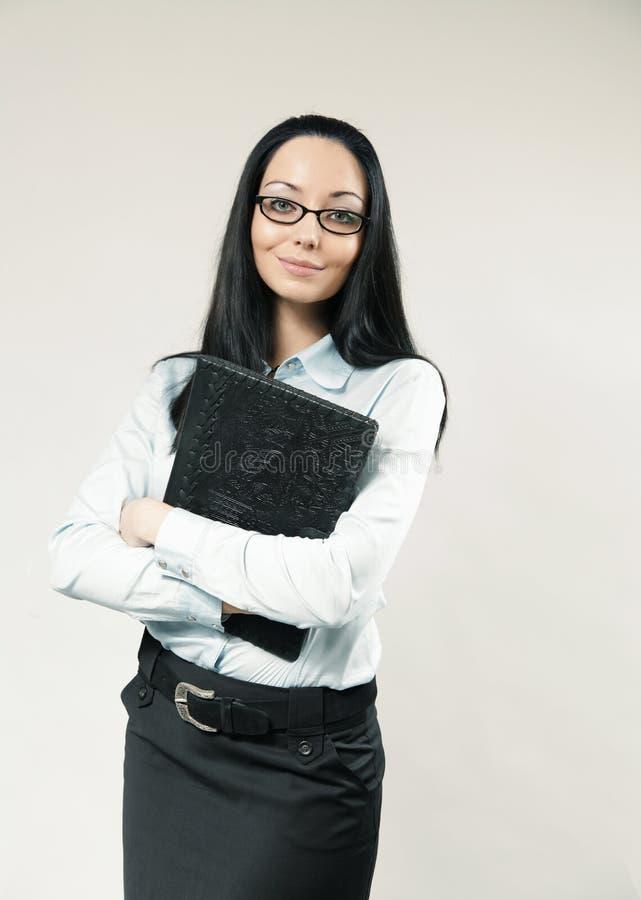 Femme d'affaires/aide/secrétaire heureux photographie stock