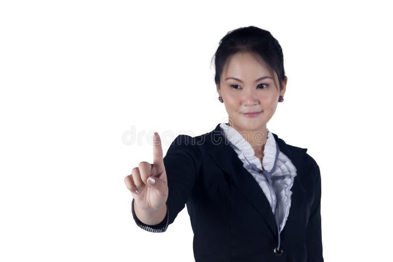 Femme d'affaires appuyant le bouton ou quelque chose. photo stock