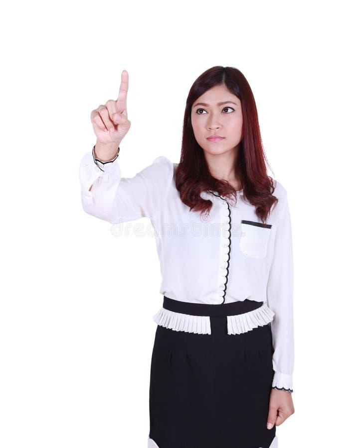 Femme d'affaires appuyant le bouton ou quelque chose photographie stock libre de droits