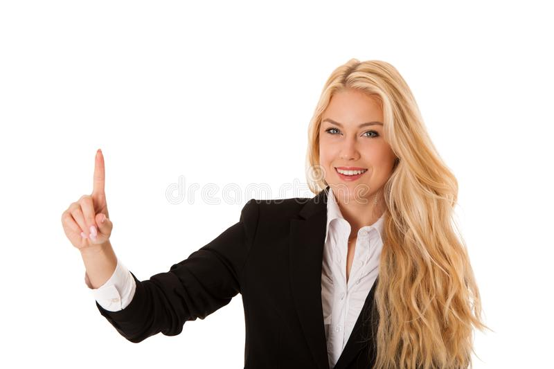 Femme d'affaires appuyant sur le bouton virtuel d'isolement au-dessus du blanc photographie stock