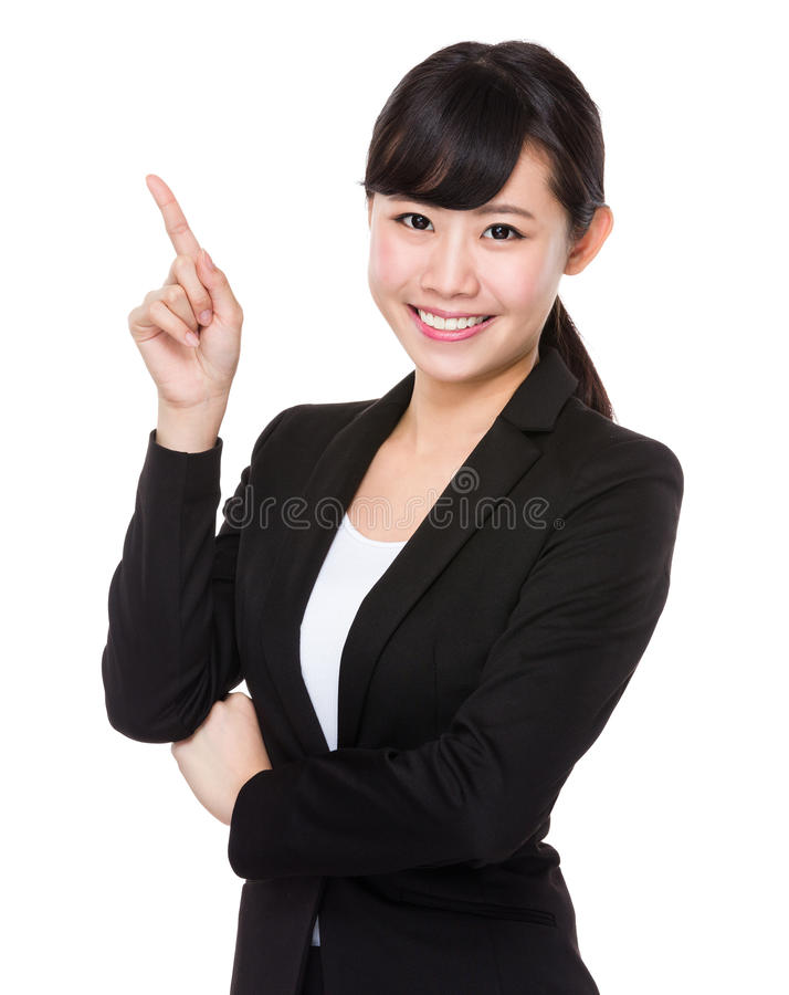Femme d'affaires asiatique avec le point de doigt  photo stock