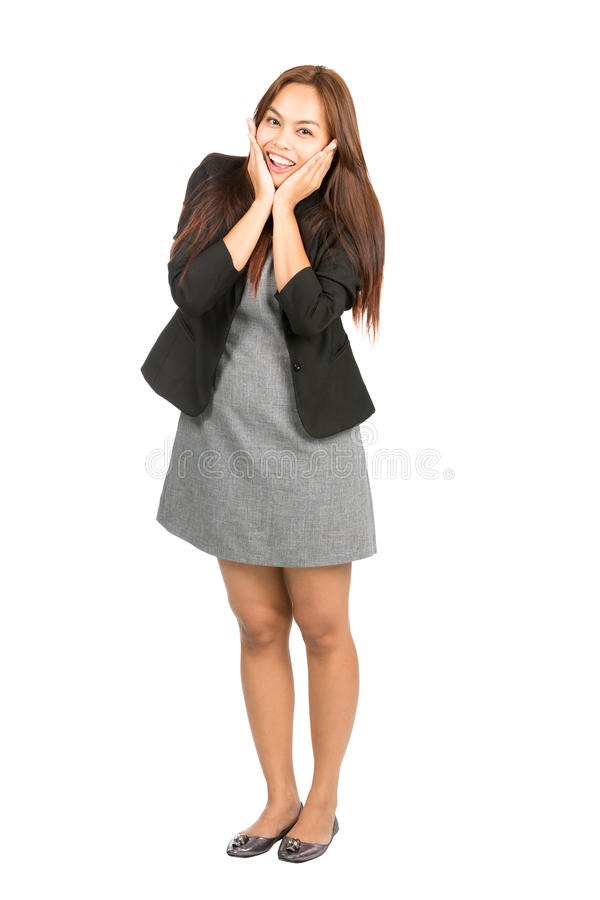 Femme d'affaires asiatique enthousiaste Cupping Chin Full photographie stock