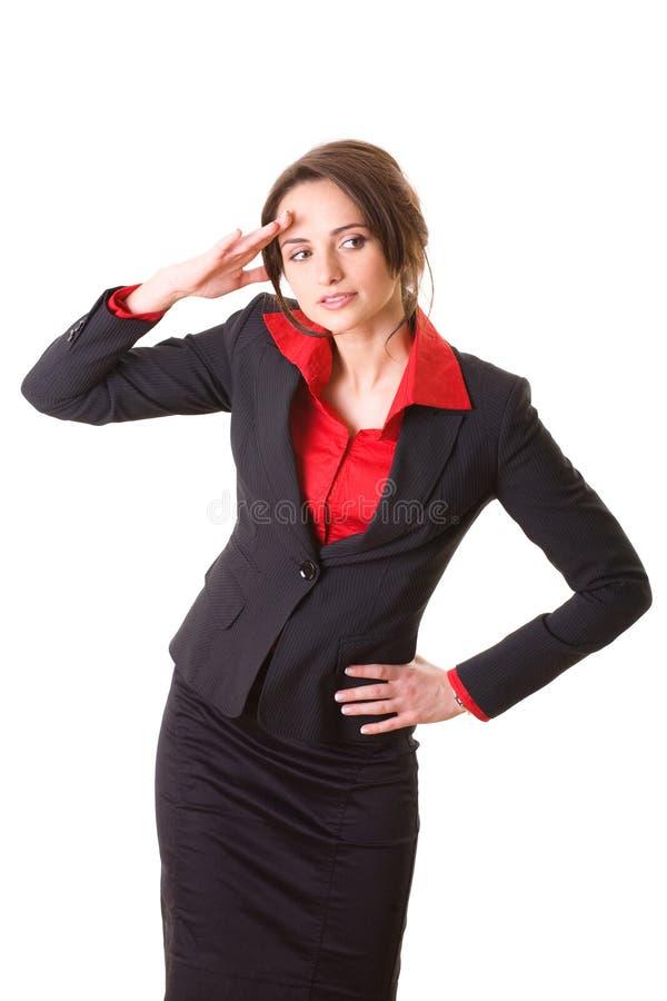Femme d'affaires attirante dans la chemise et la jupe rouges image stock