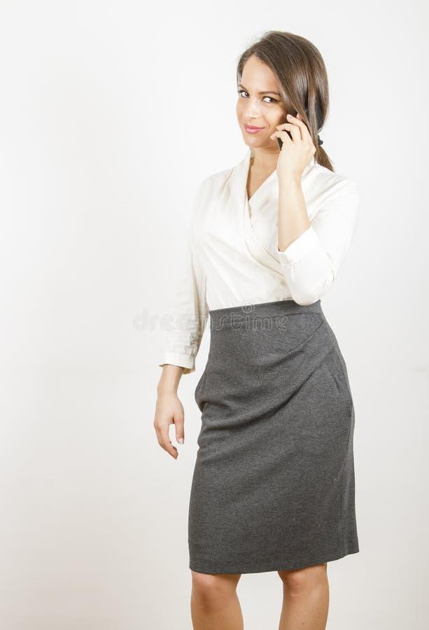Femme d'affaires au téléphone photos stock