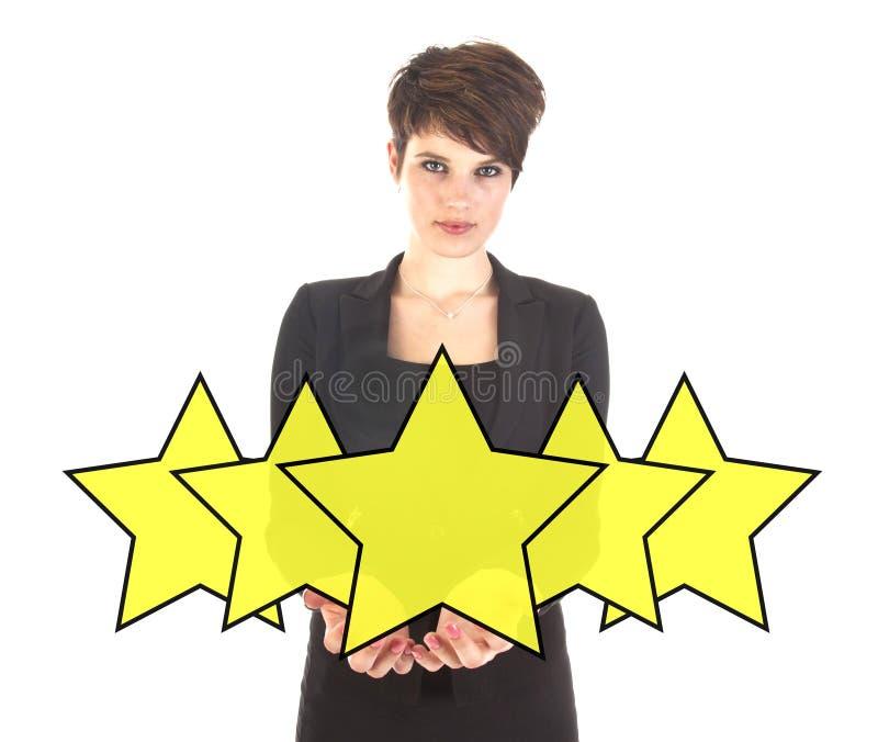 Femme d'affaires avec des étoiles de rang d'isolement images stock