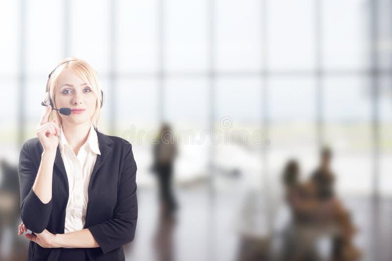 Femme d'affaires avec des casques images libres de droits