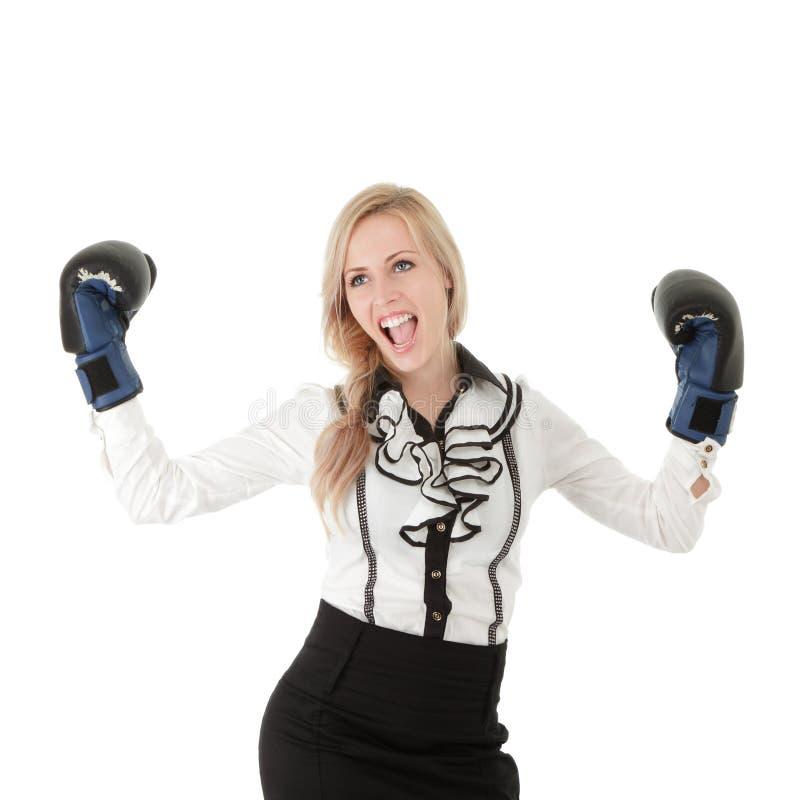 Femme d'affaires avec des gants de boxe photos stock