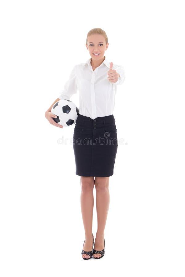 Femme d'affaires avec des pouces de ballon de football d'isolement sur le blanc photos stock