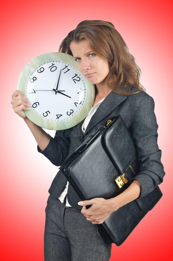 Femme d'affaires avec l'horloge images libres de droits