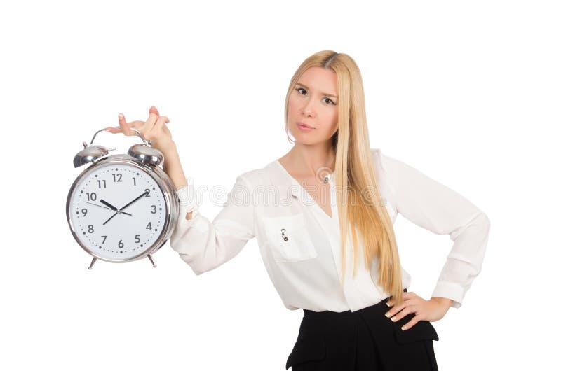 Femme d'affaires avec l'horloge d'isolement images stock