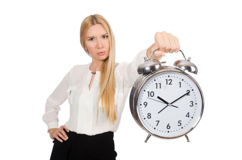 Femme d'affaires avec l'horloge d'isolement image stock