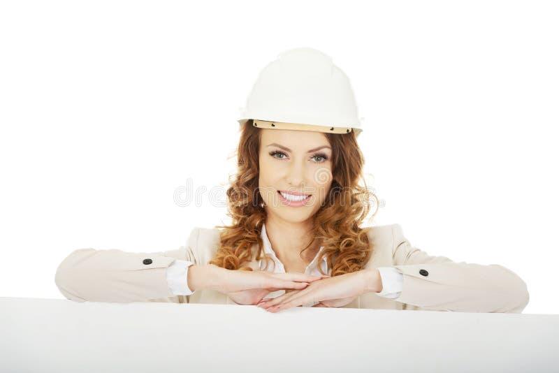Femme d'affaires avec la bannière vide image stock