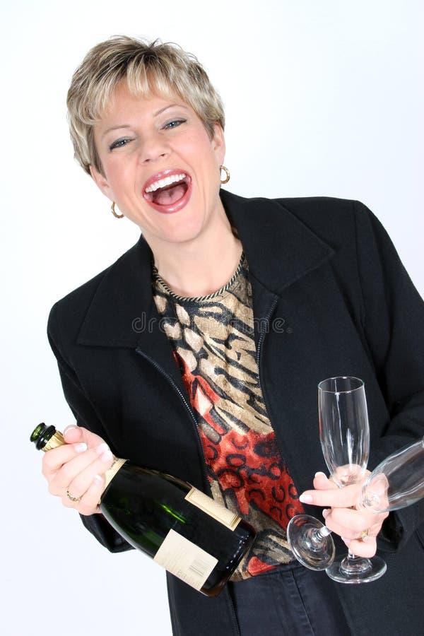 Femme d'affaires avec la bouteille de Champagne photos stock