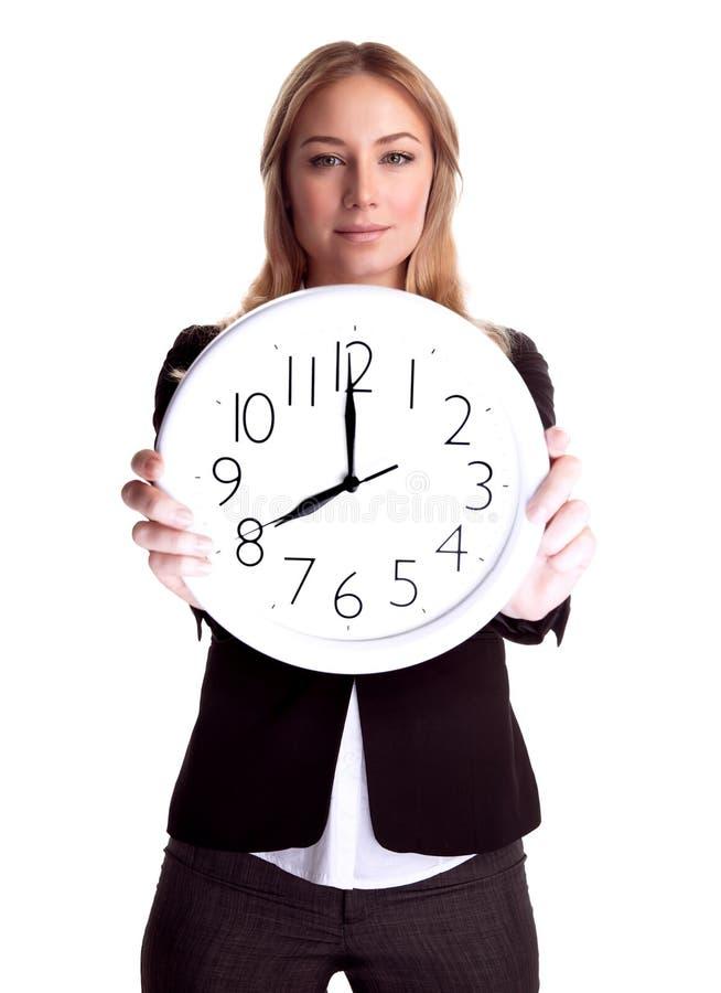 Femme d'affaires avec la grande horloge photos stock
