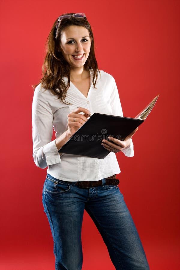 Femme d'affaires avec le dépliant images libres de droits