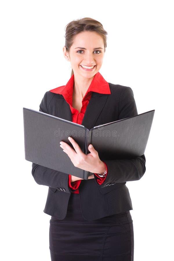 Femme d'affaires avec le dépliant ouvert de noir, d'isolement images stock