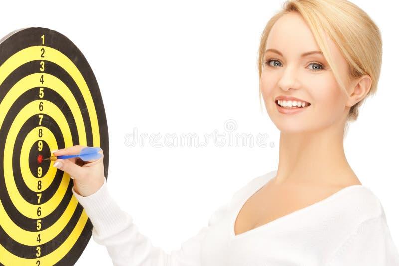 Femme d'affaires avec le dard et la cible image libre de droits