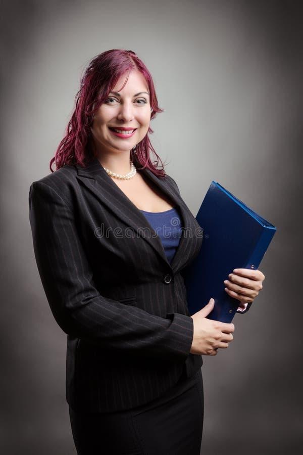 Femme d'affaires avec le dossier photos stock