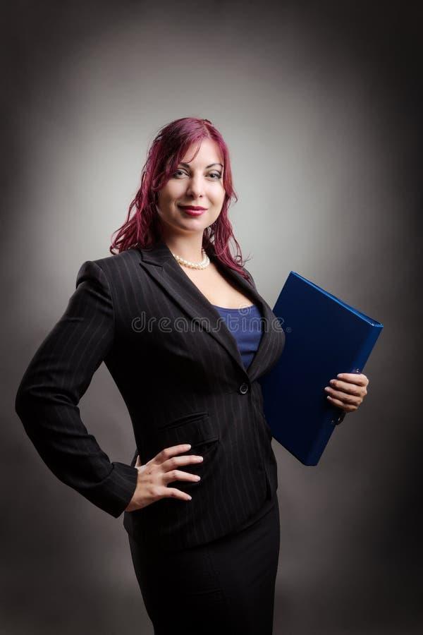 Femme d'affaires avec le dossier photographie stock