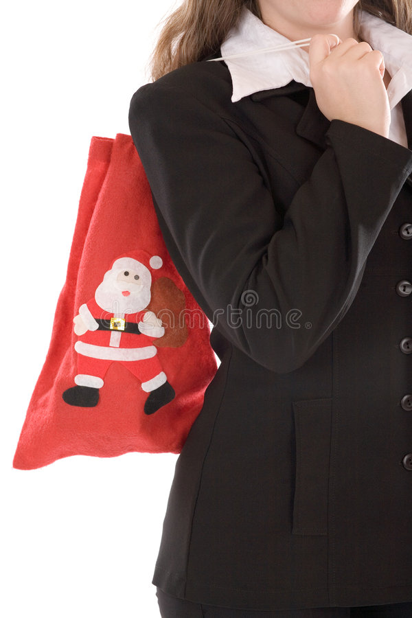 Femme d'affaires avec le sac de Santa photographie stock
