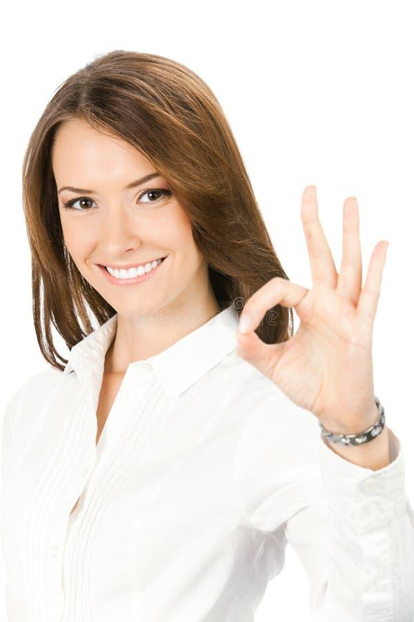 Femme d'affaires avec le signe EN BON ÉTAT, sur le blanc images libres de droits