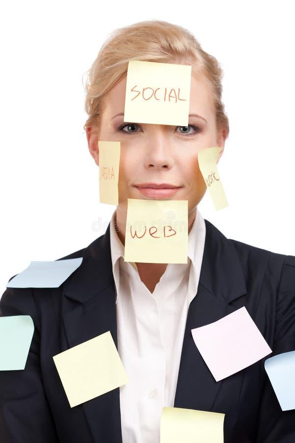 Femme d'affaires avec les collants colorés sur son visage photo libre de droits