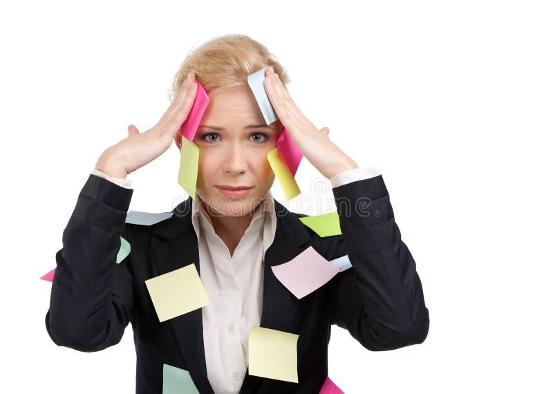 Femme d'affaires avec les collants colorés sur son visage photo stock