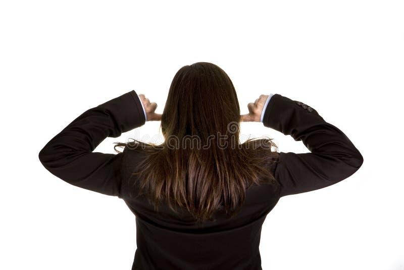 Femme d'affaires avec les deux doigts dans les oreilles photographie stock