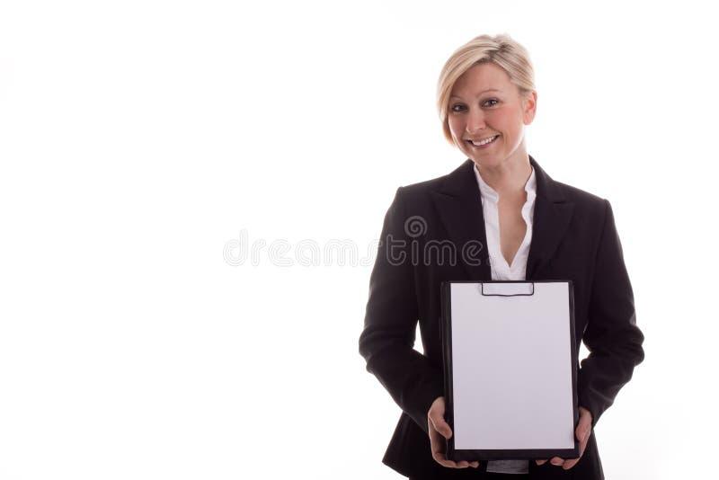 Femme d'affaires avec un bloc-notes non écrit photos stock