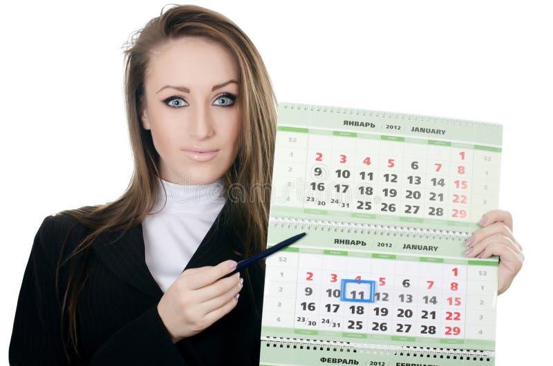 Femme d'affaires avec un calendrier photographie stock