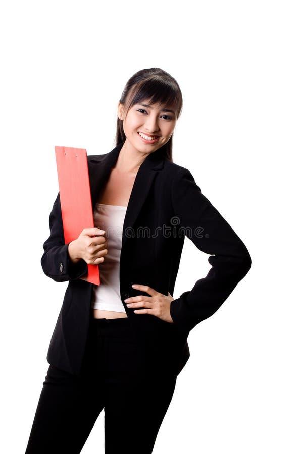 Femme d'affaires avec un fichier rouge photographie stock libre de droits