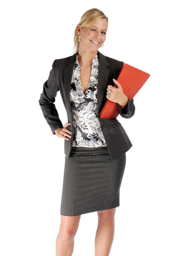 Femme d'affaires blonde attirante dans le procès noir image stock