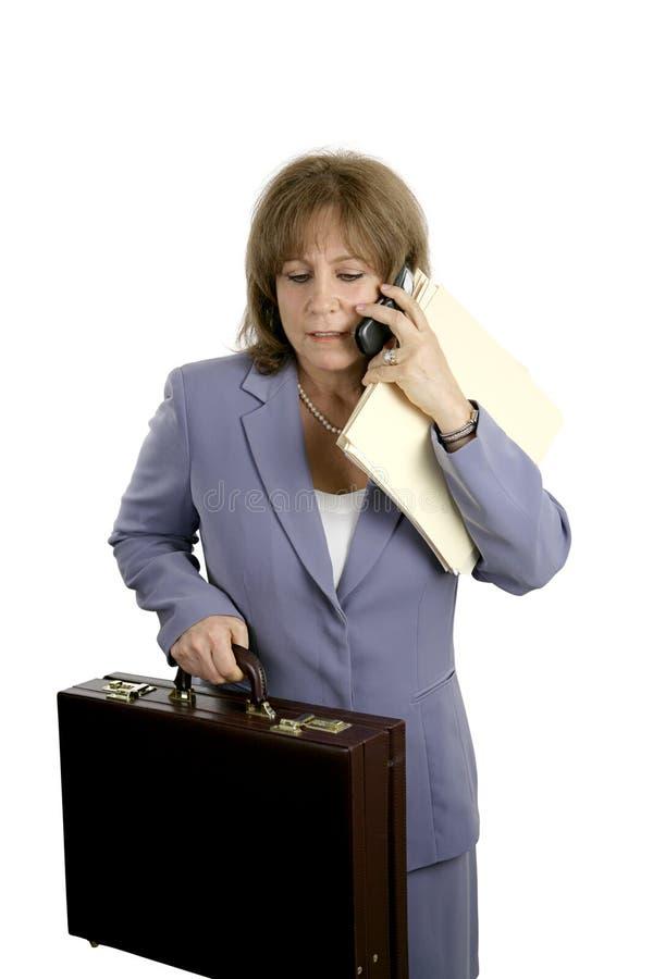 Femme d'affaires - chargée et frustrée photographie stock