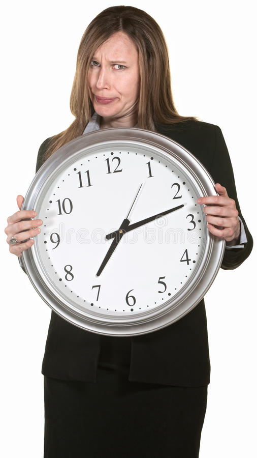 Femme d'affaires contrariée avec l'horloge photos libres de droits