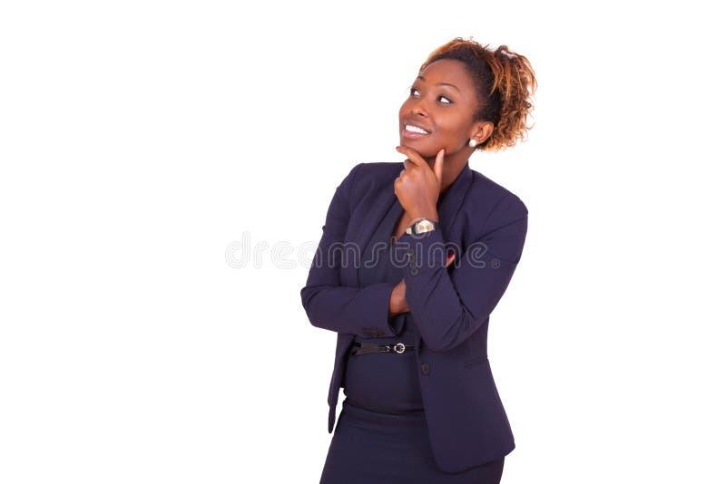 Femme d'affaires d'afro-américain avec les bras pliés recherchant, I photos libres de droits