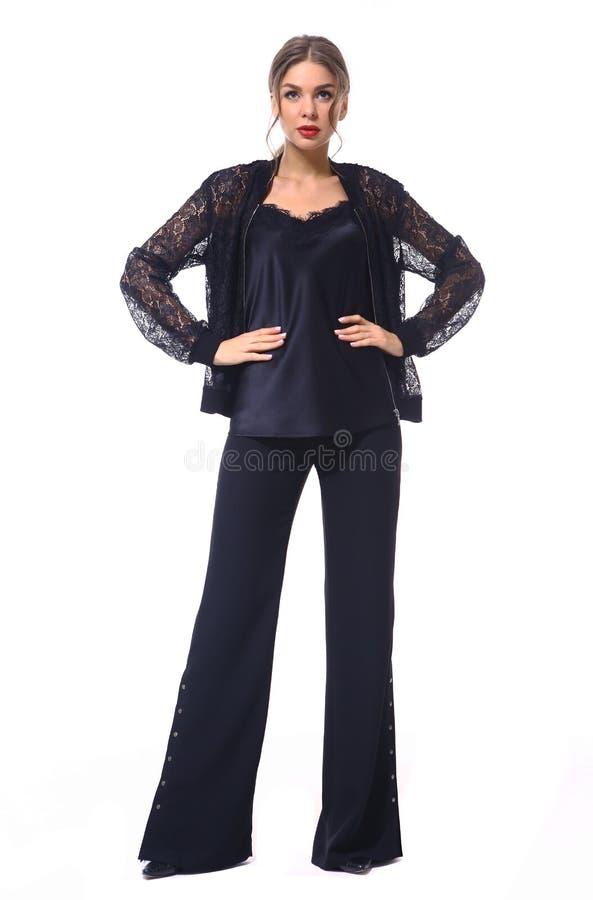Femme d'affaires dans des vêtements formels d'isolement sur le blanc photos stock